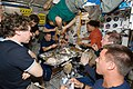 STS-127 and Expedition 20 Crewmembers eating in the Node 1 during Joint Operations.jpg