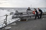 Sailors aboard the guided-missile destroyer USS Porter (DDG 78) test-fire a Mark 46 torpedo launching system. (31913707315).jpg