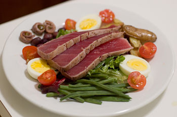 The ingredients of niçoise salad, here served with a topping of ...