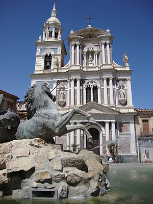 Caltanissetta - The façade of the Church of San Sebastiano in the foreground with the Triton Fountain.
