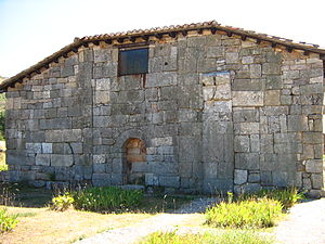 Hermitage of Santa María de Lara - A view of the surviving west face of the Visigothic church. Initially the centre part of this wall would have been on the interior of the original church.