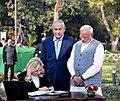 Sara Netanyahu, wife of the Prime Minister of Israel, Mr. Benjamin Netanyahu signing the visitors' book, at Teen Murti Chowk, in New Delhi on January 14, 2018. The Prime Minister, Shri Narendra Modi is also seen.jpg