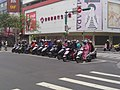 Scooters in front of Meei Hwa Tai Zhonghua Store 20140312.jpg