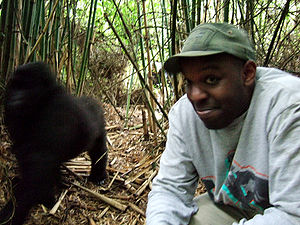 Q (radio show) - Shad photographed with a gorilla while on a visit to Rwanda, 2006
