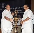 Sharad Pawar lighting the lamp to inaugurate the State Food Ministers' Meet to discuss implementation of the National Food Security Act, in New Delhi. The Minister of State (Independent Charge) for Consumer Affairs.jpg