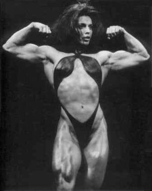 Female bodybuilding - Sharon Bruneau performing a double side bicep pose