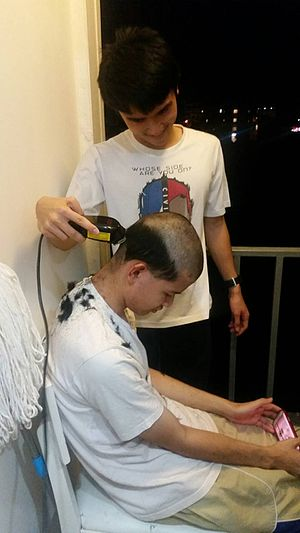 Hair clipper - Head shaving is done using an electric hair clipper.