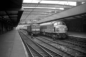 Sheffield Victoria railway station - Sheffield Victoria railway station, September 1969, a westbound diesel-hauled train arrives at Platform 3, with an electric locomotive waiting to take the train on to Manchester