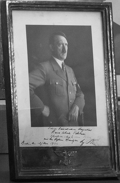 This photograph's inscription reads: His Imperial Majesty - Reza Shah Pahlavi - Shahanshah of Iran - With the Best Wishes - Berlin, 12 March 1936 - Adolf Hitler. Signed Photograph of Adolf Hitler and His Best Wishes for Reza Shah Pahlavi - Sahebgharanie Palace - Niavaran Palace.JPG
