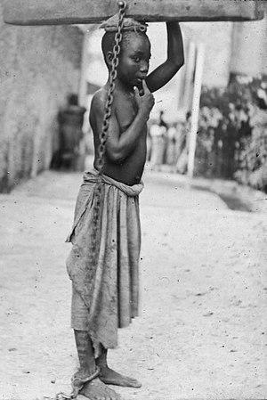Congo Arab war - A photograph of a slave boy in Zanzibar. c. 1890.