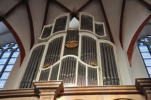 """Canonic Variations on """"Vom Himmel hoch da komm' ich her"""" - The small organ in the Thomaskirche in Leipzig, where Bach was organist and kantor 1723–1750. The organ, with its gilt Bach monogram, is a reconstruction by Gerald Woehl of a baroque organ played by Bach in the Paulinerkirche."""