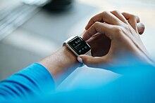 smartwatch wikipediaa person wearing an apple watch