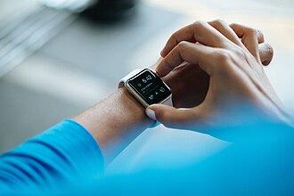Smartwatch - A person wearing a smartwatch.