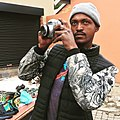 Soweto steet vendor with a vintage camera.jpg