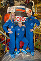 Soyuz TMA-09M crew members in front of their spacecraft.jpg