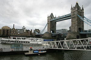 St Katharine Docks - A cruise boat departs from St Katharine Pier