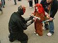 Star Wars Celebration III - Darth Maul shares his lightsaber with a little Ewok (4878266309).jpg
