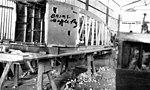 StateLibQld 1 121576 Aeroplane fuselage under construction, Cloncurry, ca. 1927.jpg