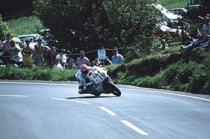 Gooseneck, Isle of Man - Steve Hislop riding the rotary-engined Norton RCW 588 exiting the Gooseneck in 1992