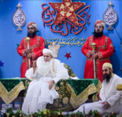 Left: Saifuddin at Saifee Masjid in South Bombay delivering his first sermon as the 53rd Dai al-Mutlaq (4 February 2014). Right: Saifuddin at his 75th birthday celebrations in Surat; seated besides him is his son, Burhanuddin (2018).