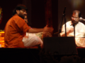 T. S. Nandakumar performing with Dr. K. J. Yesudas in Atlanta, USA.png