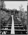 TOP VIEW; FLUME EMPTYING INTO FOREBAY LAKE-1980 - Power Flume No. 1, Tacoma, La Plata County, CO HAER COLO,33-TAC.V,3-19.tif