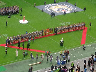 Rugby league in England - The finalists lining up before the 2014 Challenge Cup Final. The Challenge Cup is the premier knock-out tournament in England.