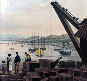 Teignmouth - The New Quay at Teignmouth in 1827 with a large crane and blocks of cut granite ready for transshipment