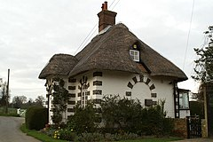 Thatched estate lodge, Frogham.jpg