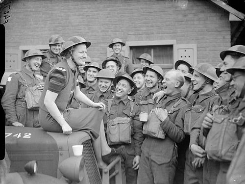 Fields shares a joke with troops in a village near Valenciennes, France, April 1940 The British Army in France 1940 F4074.jpg