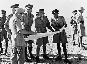 """George Philip Bradley Roberts - Lieutenant General Bernard Montgomery, the new commander of the British Eighth Army, and Lieutenant General Brian Horrocks, the new GOC XIII Corps, discussing troop dispositions at 22nd Armoured Brigade HQ, 20 August 1942. The brigade commander, Brigadier """"Pip"""" Roberts is on the right (in beret)."""