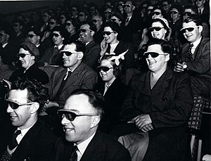 "3D film - Audience wearing special glasses watch a 3D ""stereoscopic film"" at the Telekinema on the South Bank in London during the Festival of Britain 1951."