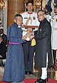 The President, Shri Pranab Mukherjee presenting the Padma Shri Award to Shri Chewang Norphel, at a Civil Investiture Ceremony, at Rashtrapati Bhavan, in New Delhi on March 30, 2015.jpg