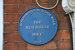 The red house blue plaque