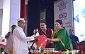 The Union Minister for Textiles, Smt. Smriti Irani honouring the Veteran Weaver, Shri Haji Nizamuddin ji, at the 2nd National Handloom Day, at BHU, Varanasi, Uttar Pradesh.jpg