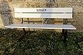 "Tjøme kirke Church White bench (parkbenk) marked ""The Church"" (""Kirken"") by stone wall Winter afternoon light light No snow Færder Municipality, Norway 2020-01-15 1862.jpg"