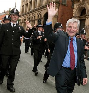 Tony Lloyd - Tony Lloyd parading with the Greater Manchester Police at the 2013 Manchester Pride festival.