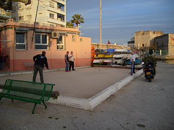 Men playing petanque next to the Port St. Louis in Toulon Toulon Playing Boules.jpg