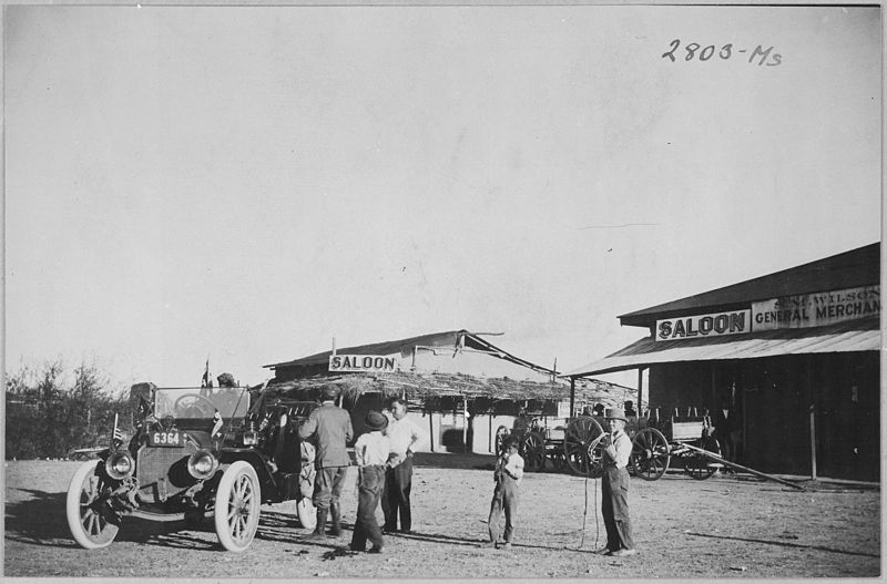 File:Townspeople of Ehrenburg, Ariz. Terr., greet a stranger in an automobile on his pioneer cross country tour. Saloon in ba - NARA - 513354.jpg