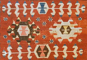 Kilim motifs - Tree of Life (Hayat Aǧacı, top and bottom of image) symbolizes the desire for immortality. Each Tree of Life symbol here contains at its centre an Earring (Küpe) motif, a wedding present symbolizing the desire for marriage.
