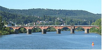 Ancient Rome and wine - The Roman bridge of Trier crosses the river Mosel. The Romans found that planting vines on the steep banks along the river provided enough warmth to ripen wine grapes.