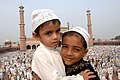 Two young children greeting each other after offering Namaz at Jama Masjid on the occasion of Id-ul-Fitr, in Delhi on October 02, 2008.jpg