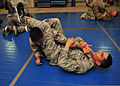 U.S. Air Force Senior Airman Robert Segovia, right, a heating, ventilation and air conditioning journeyman with the 380th Expeditionary Civil Engineer Squadron, attempts to perform an arm bar on Senior Airman 140110-F-XR500-276.jpg