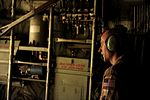 U.S. Air Force Tech. Sgt. Adam Nixon, a C-130H Hercules aircraft loadmaster assigned to the 746th Expeditionary Airlift Squadron, sits at the end of the ramp waiting for ground crew to unload cargo in support 100822-F-KV470-364.jpg
