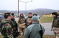 U.S. Army 1st Sgt. Stephen Cosmanic, front center, with the New Jersey Army National Guard, discusses operations with Albanian soldiers during a military adviser team (MAT) and police adviser team (PAT) training 131213-A-LO967-006.jpg