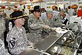U.S. Army Command Sgt. Maj. Zacchaeus Hurst, left, and Lt. Col. Henry Perry with 4th Battalion, 227th Aviation Regiment, 1st Cavalry Division, serve Thanksgiving lunch to Soldiers at Camp Buehring, Kuwait 131128-A-AY590-930.jpg