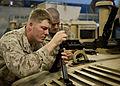 U.S. Marine Corps Lance Cpl. Francis Quinn, with the 24th Marine Expeditionary Unit (MEU), cleans an M240B medium machine gun in the well deck of the amphibious transport dock ship USS New York (LPD 21) 120412-N-XK513-037.jpg