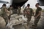 U.S. Marines transport supplies to build Ebola Treatment Units 141121-M-PA636-074.jpg
