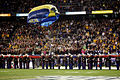 U.S. Navy Lt. Dan Gibson, a member of the Navy parachute demonstration team, the Leap Frogs, descends into Qualcomm Stadium during the opening ceremonies of the NCAA's Holiday Bowl Dec. 30, 2013, in San Diego 131230-N-ES115-563.jpg