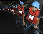 U.S. Sailors heave in a line during a replenish at sea aboard the aircraft carrier USS Nimitz (CVN 68) in the Indian Ocean June 2, 2013 130602-N-AZ866-060.jpg